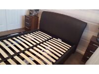 Chocolate brown leather bed with storage