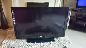"Sanyo 37"" flatscreen tv with swinging arm wall mount"