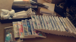 2 x Nintendo Wii. 6 Controllers. Tons of games. + PS3