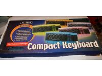 New & boxed ps/2 keyboard in translucent blue