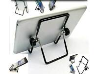 Adjustable stand for tablet.