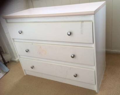 chest of white drawers with pink top.