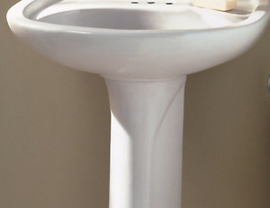 Pedestal Sink a set of taps and drain included