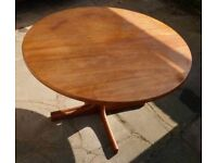 Dining table teak round which has tw extension leaves