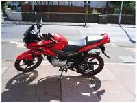 Red Honda 125 cbf
