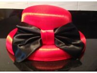 Red hat with black bow and hat box