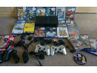 PlayStation 2 with games and buzz