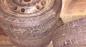 4 studded winter tires on rims St. John's Newfoundland image 3