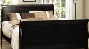New condition black wood queensize sleigh bed