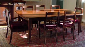 Spectacular large mahogany dining table with two leaves