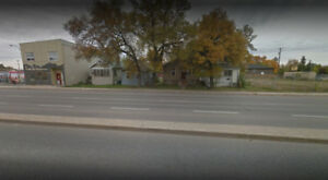 4 House in a row For Sale in Regina - Commercial Development!