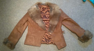 Danier leather jacket with rabbit fur collar and cuffs.