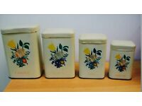 Vintage French set of 4 graduated storage tins with flower design.
