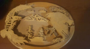 wooden carving of eagles