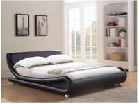 Double ottoman faux leather bed!