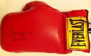 Muhammad Ali Aka Cassius Clay Autographed boxing glove with COA