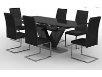 BRAND NEW HARVEYS NERO GLASS EXTENDABLE TABLE AND 6 MATCHING CHAIRS
