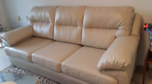 Beige Faux Leather Sofa - less than 1 yr old.