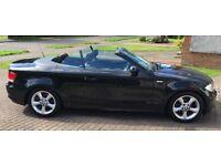 2009 BMW 1 series convertible, 25,400 miles, black metallic. Full service history.