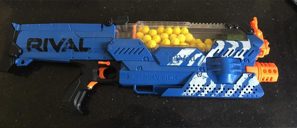 """One of the coolest parts is that the gun is sized so that it holds 100  balls at a time. Power comes from six """"D"""" cell batteries or NERF's new Rival  ..."""