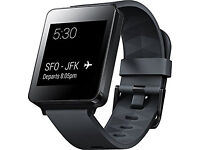 LG G Watch W100 with a box and charger