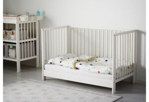 White crib comes with bedding, 2 set of bumpers, musical mobile