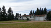 Large newer home on 10 acres NW of Melfort!