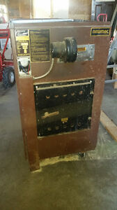 Forced air wood furnace