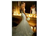 Beautiful Stella York lace beaded strapless fishtail wedding dress with diamante sash