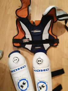 Youth Large shoulder pads and shin pads for sale