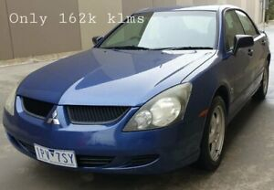 2004 Mitsubishi Magna TL ES Blue 4 Speed Sports Automatic Sedan Cheltenham Kingston Area Preview