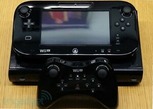 Wii U 32GB with two controllers 4 games