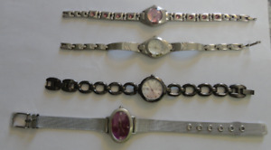 3 Watches Silver/ 1 Brown metal: $8.00 each. Number: Watch67