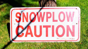 Snowplow Caution Sign Now That Winters Over
