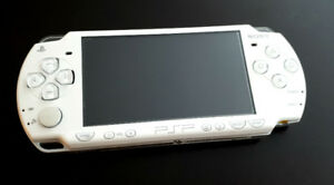 white pearl color PSP 2000 with a few games - Mint condition