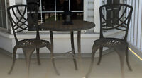 Solid wrought iron table and chairs