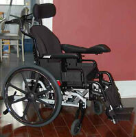 Deluxe Wheelchair - New Condition.