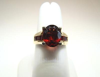 - Garnet Bridge 14K Yellow Gold Lady's Ring Nice!!!