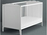 IKEA cot bed with mattress, fitted sheet and bumper pad in very good condition