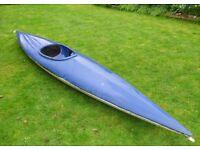 Blue and white fibreglass kayak