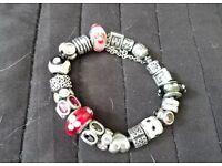 Genuine PANDORA bracelet with 18 Charms.