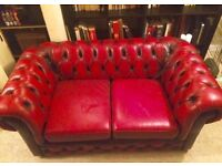 Two seater Leather Chesterfield in red