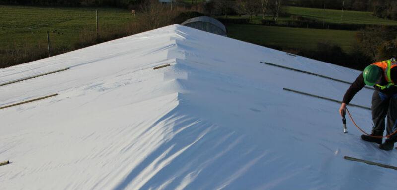Heat shrinking the scaffold sheeting 'drum tight' using a propane gas hot air gun