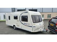 BAILEY PAGEANT FIXED BED + MOTOR MOVER + AWNING