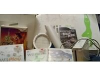 Wii console and accesories inc Wii fit board, zumba, Wii sorts + and other family games