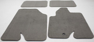 New Old Stock OEM Ford Escape Mariner 4-Piece Floor Mat Set Round Grommet Hole 2007 Ford Escape 4 Piece