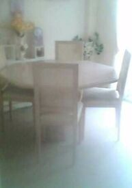 Solid wood extendable dining table and 4 chairs