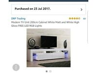 Large white tv stand, with lights. Tv not included