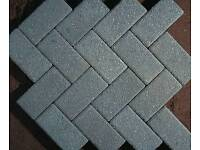 Wanted, grey block paving