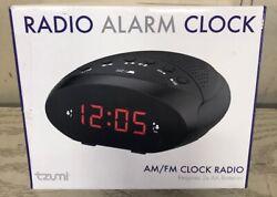 Tzumi AM/FM Radio Alarm Clock (Brand New) (Sealed). AM/FM Radio Alarm Clock